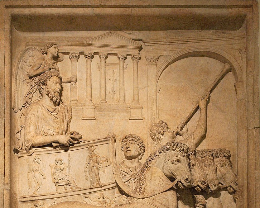 834px-Bas_relief_from_Arch_of_Marcus_Aurelius_triumph_chariot